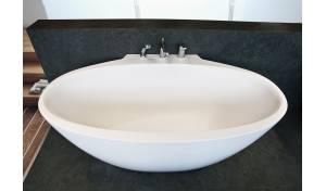 Aquatica Sensuality Mini-Wall™ Back To Wall Solid Surface Bathtub