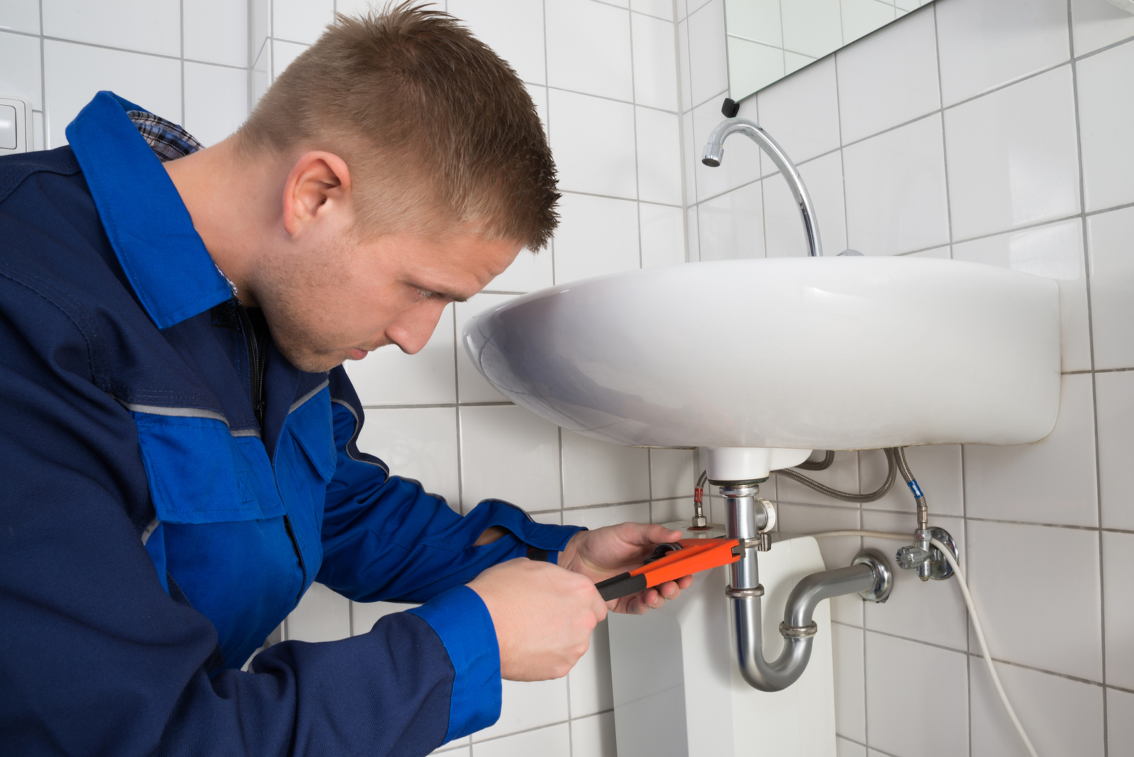 bigstock Male Plumber Fixing Sink In Ba 118654115